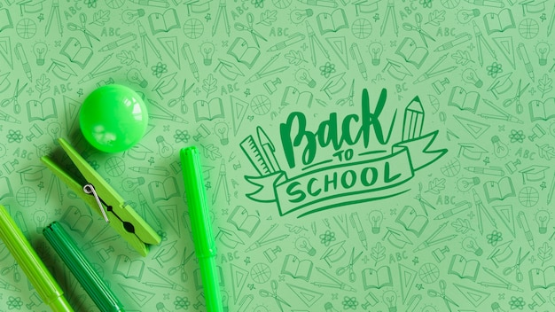 Arrangement with green supplies for back to school event Free Psd