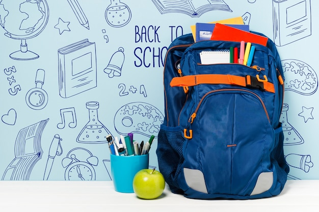 Arrangement with school bag and supplies Free Psd