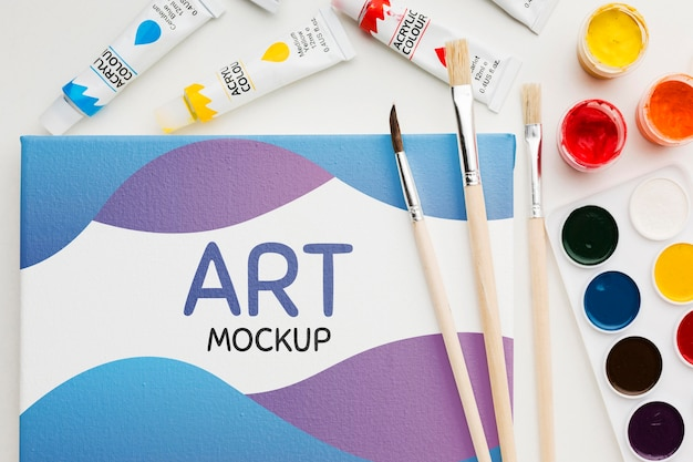 Art mock-up with watercolors above view Free Psd