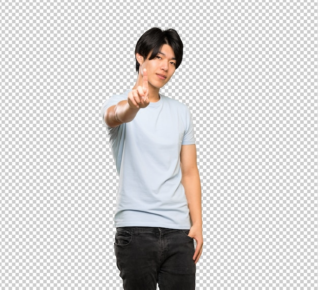 Asian man with blue shirt showing and lifting a finger Premium Psd