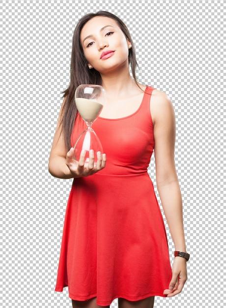 Asian woman holding a sand timer Premium Psd