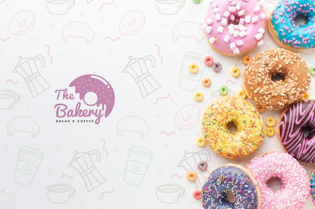 Assortment of colorful donuts with mock-up Free Psd