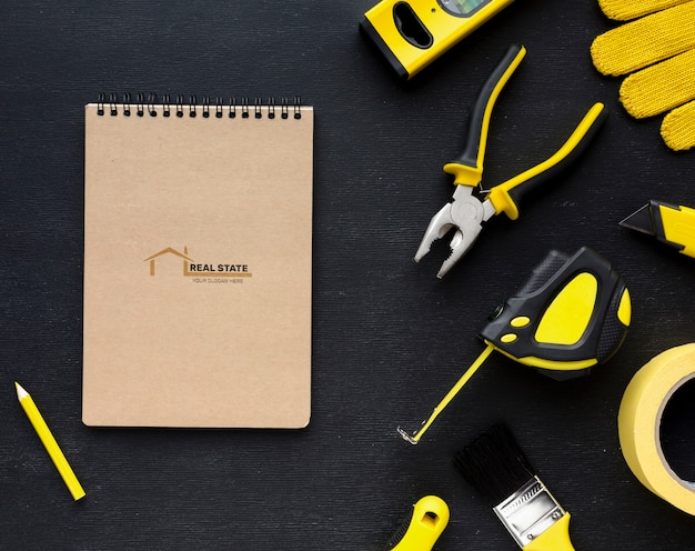 Assortment of different repairing tools with notepad mock-up Free Psd