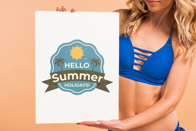 Attractive woman in bikini presenting cover mockup Free Psd
