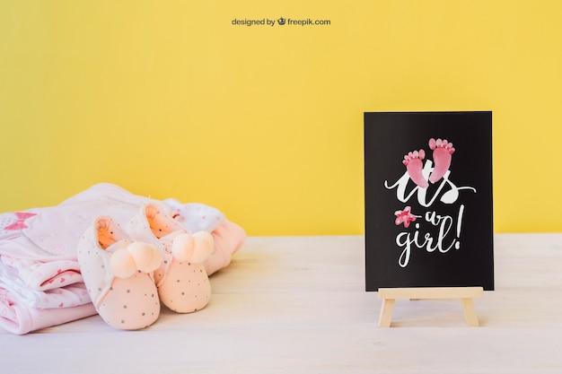 Baby girl mockup with board and shoes Free Psd