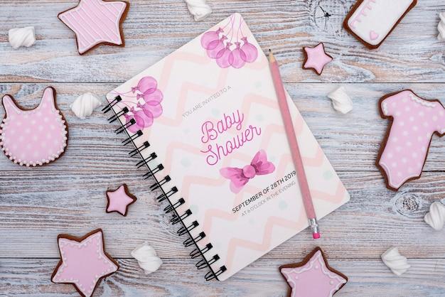 Decorazioni per baby shower con quaderno rosa Psd Gratuite