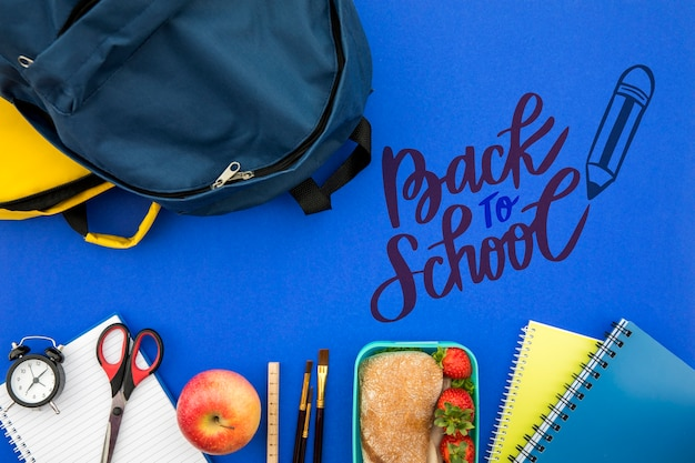Back to school, backpack with student supplies Free Psd