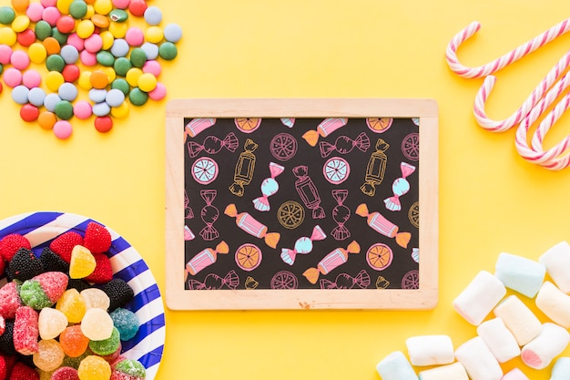 Back to school composition with slate and sweets Free Psd