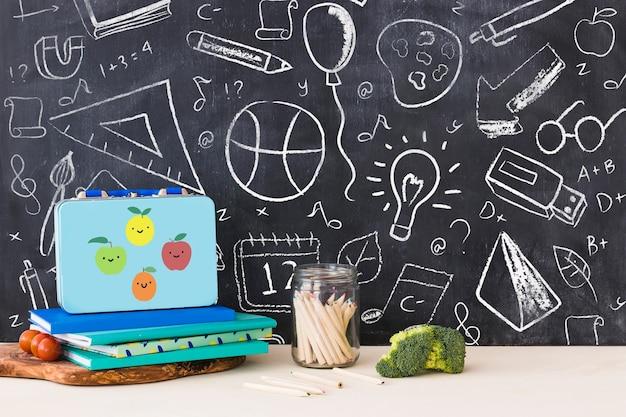 Back to school mockup with chalk on blackboard Free Psd