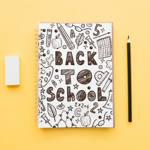 Back to school mockup with notebook cover Free Psd