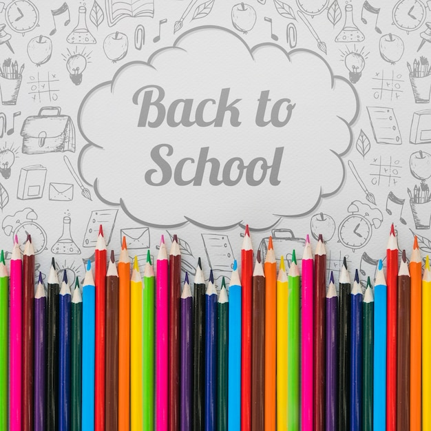 Back to school mockup with pencils and speech bubble Free Psd