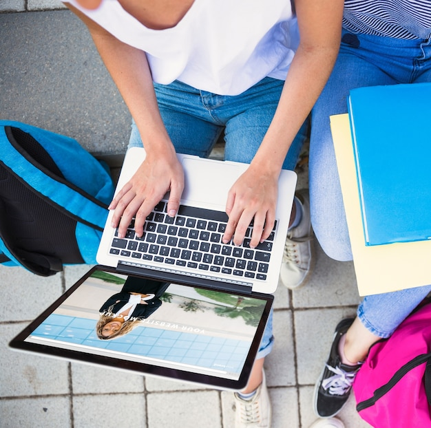 Back to school concept with girl using laptop