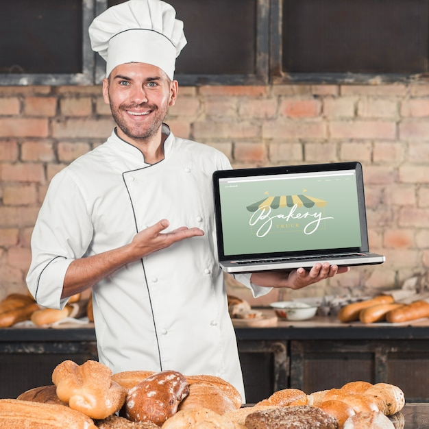 Bakery mockup with laptop Free Psd