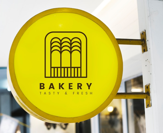 Bakery store's yellow shop sign mockup Free Psd