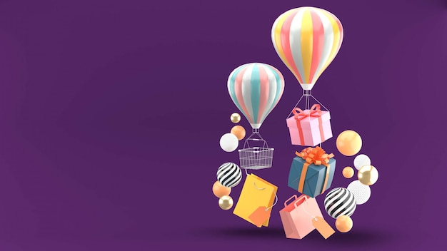 Balloon, gift box and shopping bag surrounded by colorful balls on purple Premium Psd