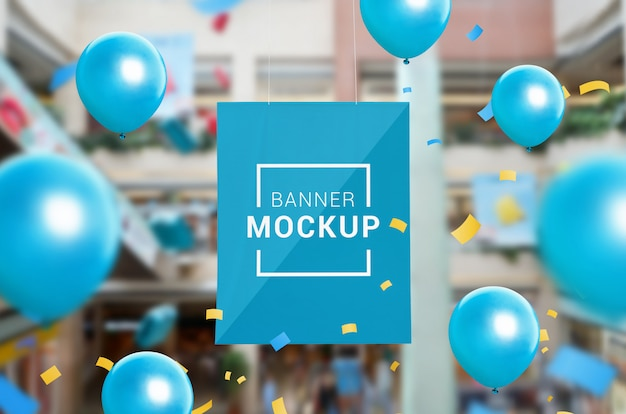 Banner mockup hanged inside the shopping mall. surrounded by confetti and balloons. sales promotion Premium Psd