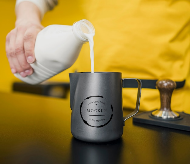 Barista pouring milk in jug mock-up Free Psd