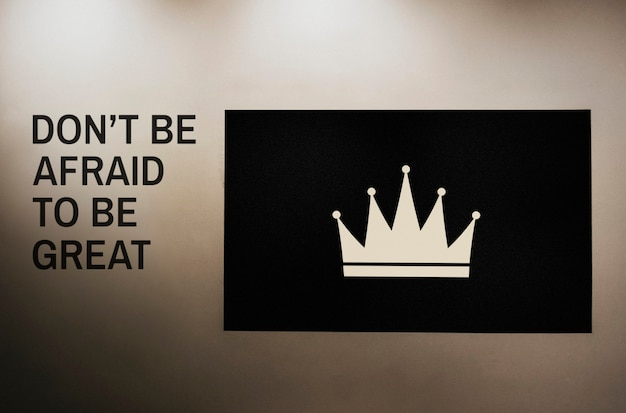Don't be afraid to be great quoted on a wall next to a crown board mockup Free Psd