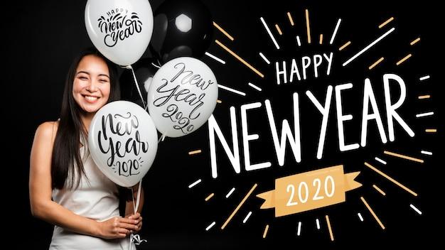 La bella tenuta della ragazza balloons il buon anno 2020 Psd Gratuite