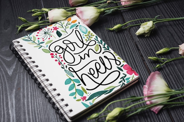 Beautiful notebook cover mockup with floral decoration Free Psd