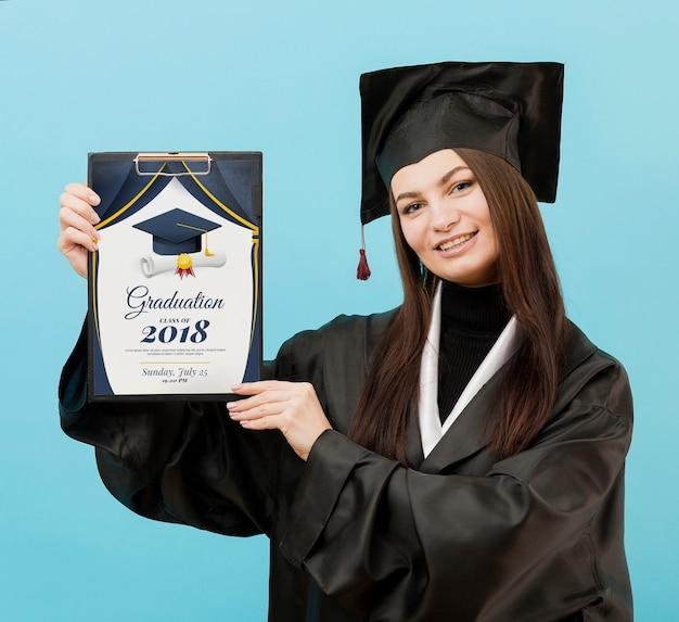 Beautiful student holding graduation diploma Free Psd