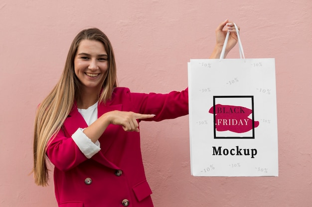 Beautiful woman with black friday bag concept Free Psd