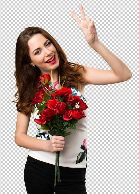 Beautiful young girl holding flowers making victory gesture Premium Psd