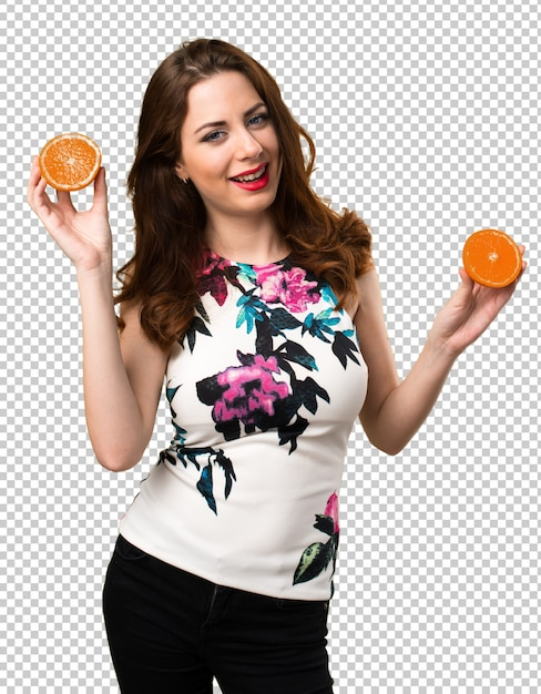 Beautiful young girl holding oranges Premium Psd