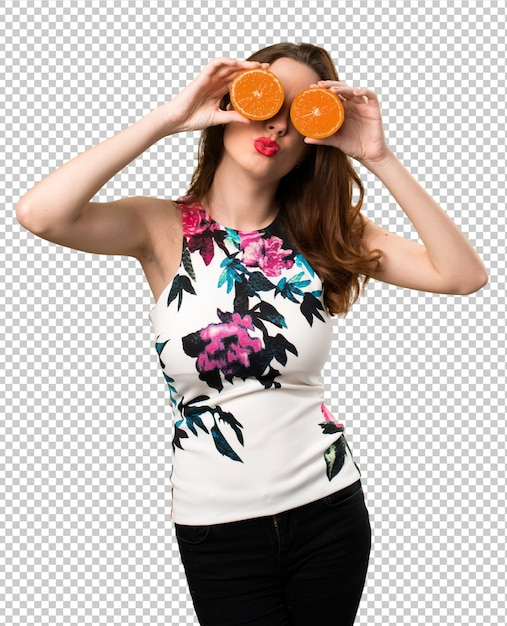 Beautiful young girl wearing orange slices as glasses Premium Psd