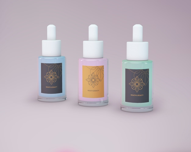 Mockup di prodotti di bellezza di tre bottiglie Psd Gratuite