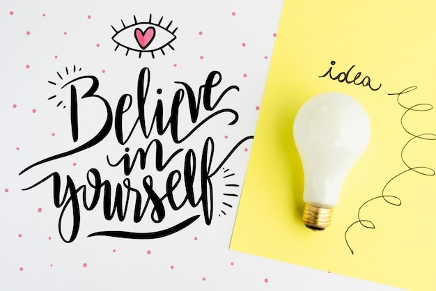 Believe in yourself quote with realistic light bulb Free Psd