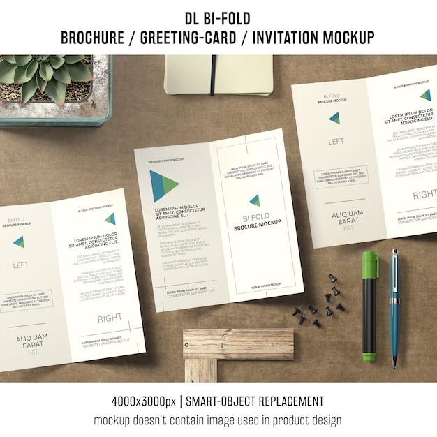 Bi-fold brochure or invitation mockup with still life concept Free Psd