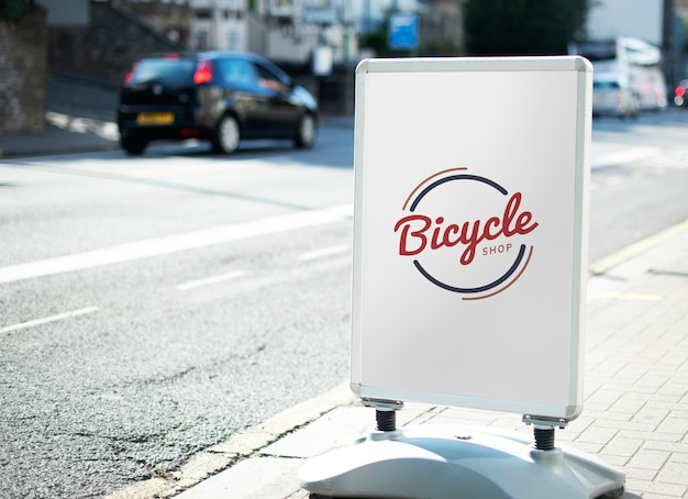 Bicycle shop sign on the street of the city Free Psd