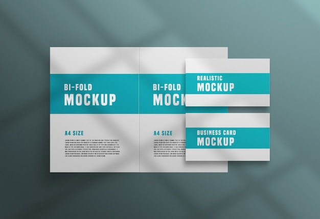 Bifold brochure with a business card psd mockup Free Psd