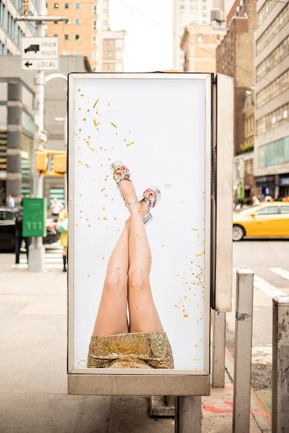 Billboard mock-up with woman Free Psd