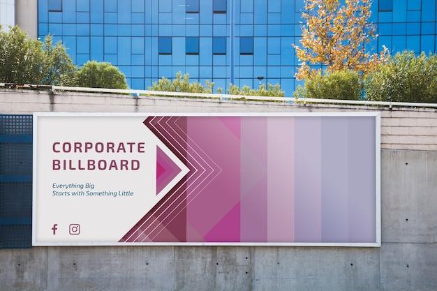 Billboard mockup on concrete wall Premium Psd