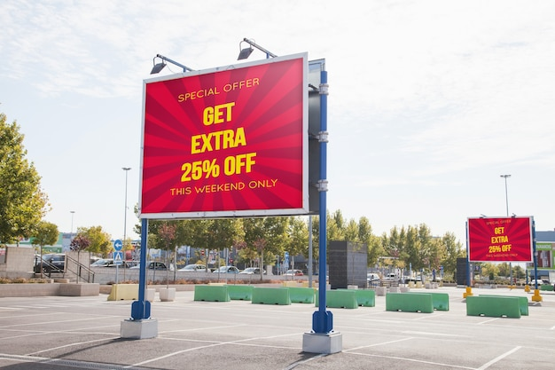 Billboard mockup at parking lot Free Psd