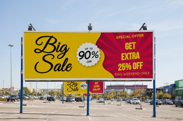 Billboard mockup at parking lot Free Psd