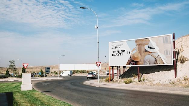 Billboard mockup next to road Premium Psd