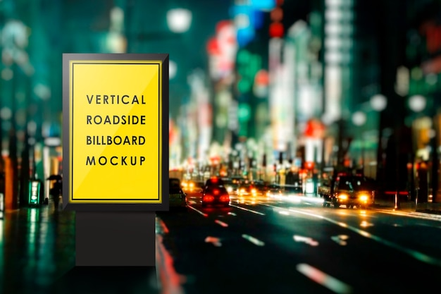 Billboard mockup on roadside at night Premium Psd