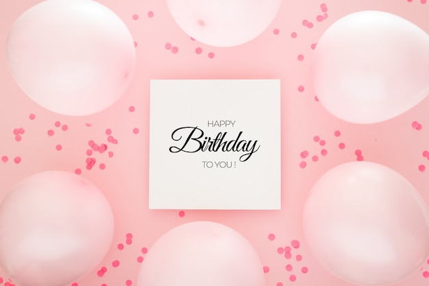 Birthday background with pink confetti and balloons Free Psd
