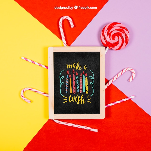 Birthday mockup with slate and candy Free Psd
