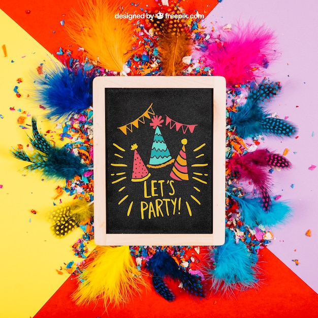 Birthday mockup with slate and feathers Free Psd