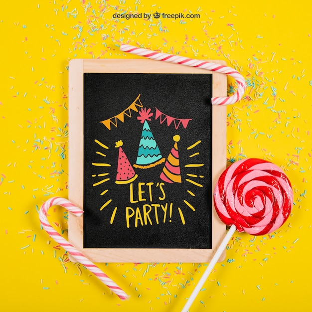 Birthday mockup with slate and lollipop Free Psd