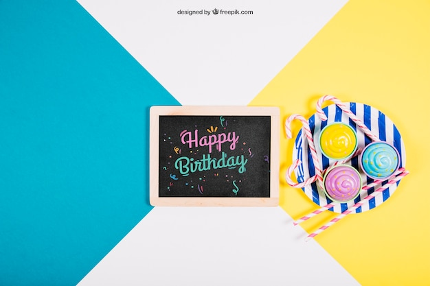Birthday mockup with slate and plate Free Psd