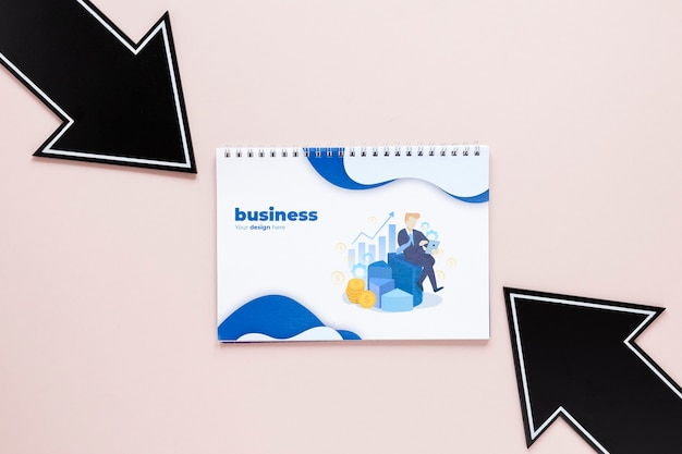 Black arrows and business notebook Free Psd