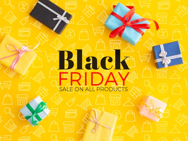 Black friday concept with gifts on yellow background Free Psd