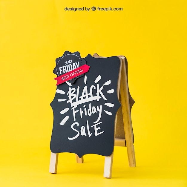 Black friday mockup with decorative board Free Psd