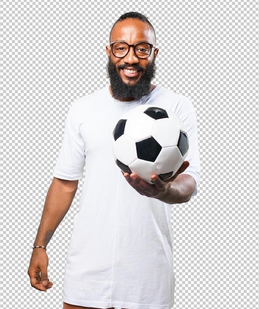 Black man holding a soccer ball Premium Psd