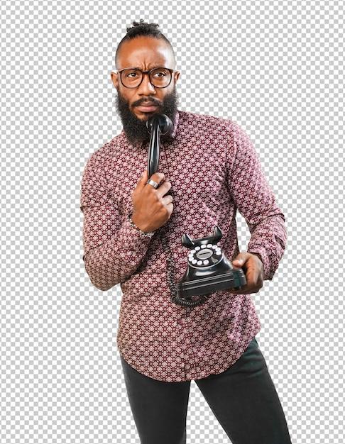 Black man thinking holding  telephone Premium Psd
